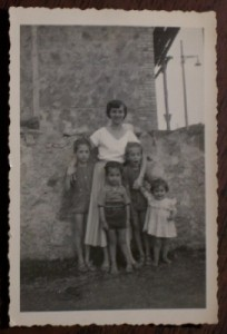 Mom in Italy with cousins, 1950. Age 18.