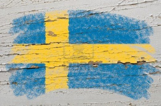 10605951-chalky-swedish-flag-painted-with-color-chalk-on-grunge-wooden-texture